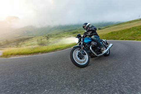 One motorcycle that is being ridden by a rider in a scenic area