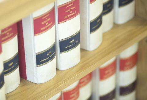 A book shelf that contains numerous legal books