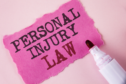 """Pink paper with marker and text, """"Personal injury law"""""""